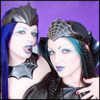 Blue-Haired Alt Superstars Scar 13 and Darenzia in Armor